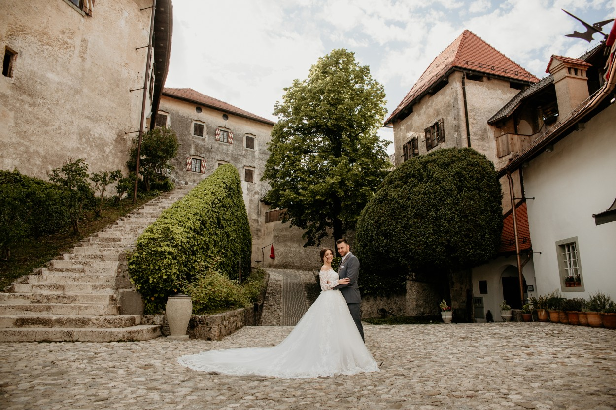 Bride and groom hug before Lake Bled Castle wedding.jpg
