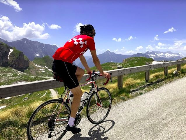 Chris cycling up to Mangart's 2,679m peak.JPG
