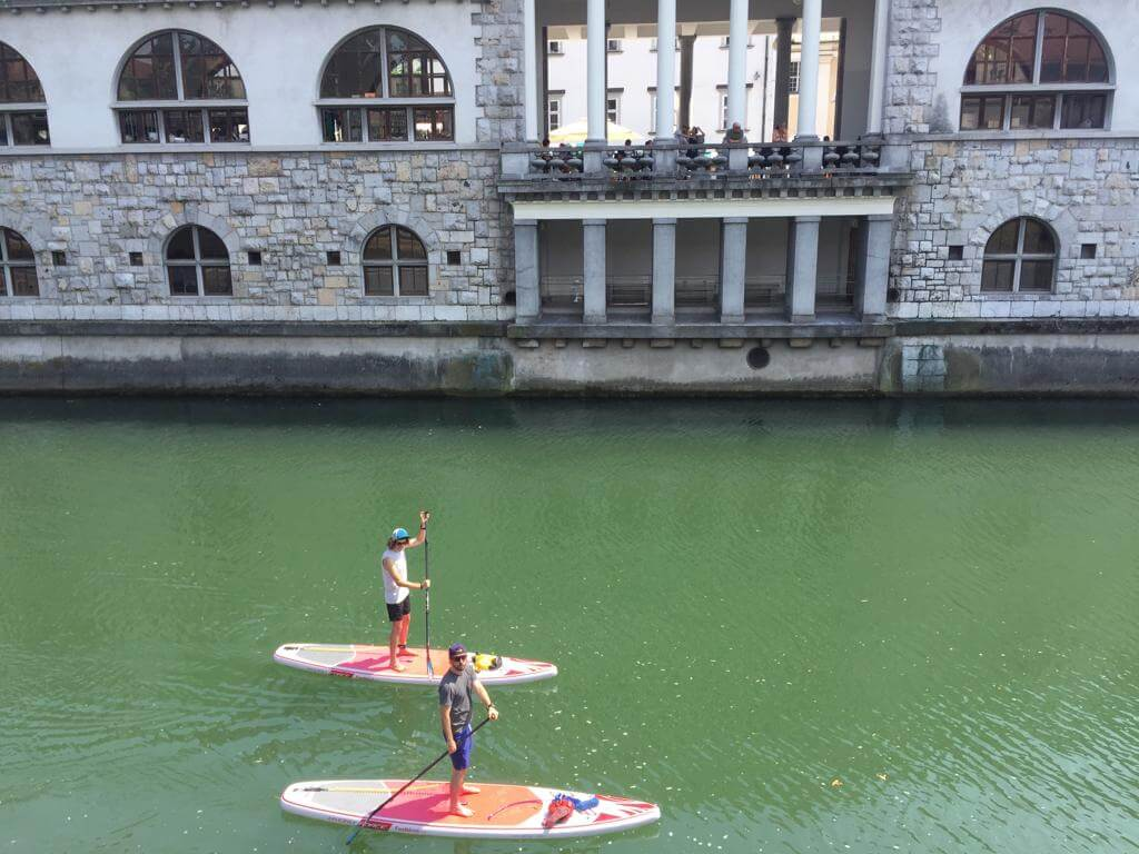 Ross and Chris SUP through the centre of Ljubljana.JPG