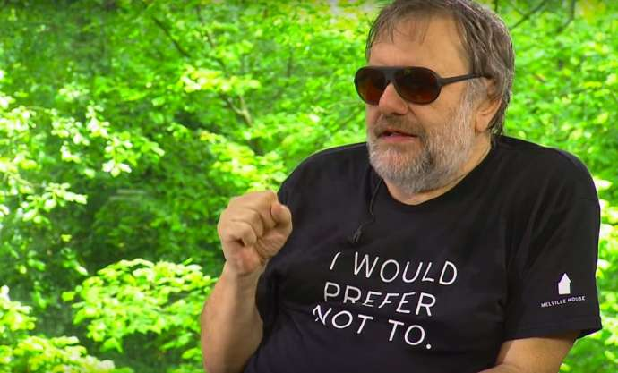 "Žižek in ""They Live"" sunglasses and a Melville T-shirt"