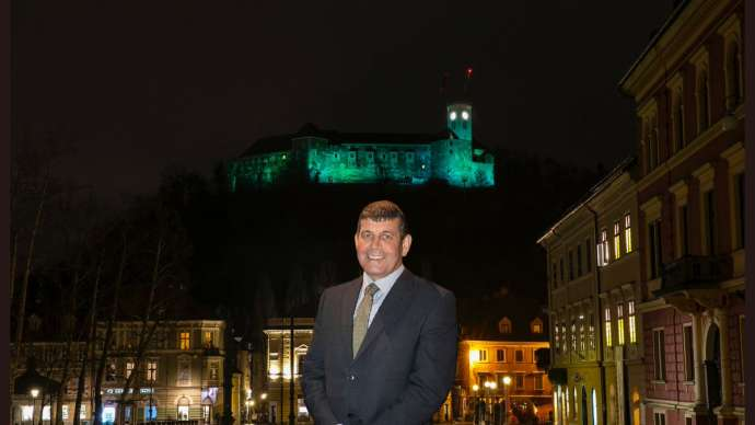 The Irish Minister of State for Food, Forestry and Horticulture Andrew Doyle in Ljubljana, with the Castle turned green for St Patrick