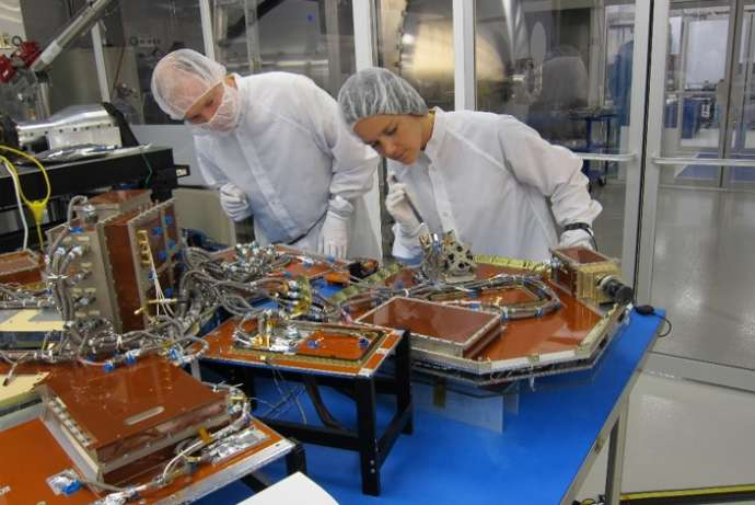 This is actually a picture of  NEMO-HD, the microsatellite, during integration. This will go into space along with Trisat, the nanosatellite